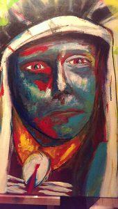 Kleurrijk schilderij Indiaan gezicht